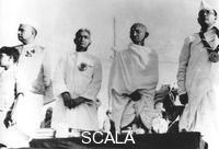 ******** Members of the Indian National Congress on the dais at Haripura, India, 1st March 1938. From left to right, Jamnalal Bajaj, Darbar Gopoldas Dasai, Mahatma Gandhi (Mohandas Karamchand Gandhi) and Subhas Chandra Bose