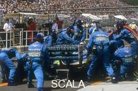 ******** Pit stop for Michael Schumacher's Benetton-Ford, 1994.